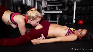 Lesbians in open crotch leggings licking